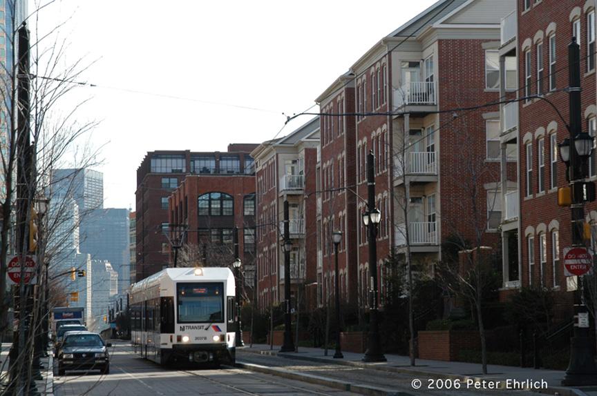 (205k, 864x574)<br><b>Country:</b> United States<br><b>City:</b> Jersey City, NJ<br><b>System:</b> Hudson Bergen Light Rail<br><b>Location:</b> Along Essex Street <br><b>Car:</b> NJT-HBLR LRV (Kinki-Sharyo, 1998-99)  2037 <br><b>Photo by:</b> Peter Ehrlich<br><b>Date:</b> 1/25/2006<br><b>Notes:</b> At Essex/Warren Streets outbound.<br><b>Viewed (this week/total):</b> 0 / 1649
