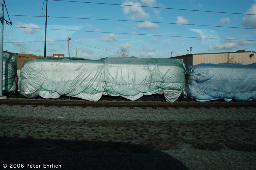 (184k, 864x574)<br><b>Country:</b> United States<br><b>City:</b> Jersey City, NJ<br><b>System:</b> Hudson Bergen Light Rail<br><b>Location:</b> HBLR Shops/Yard <br><b>Photo by:</b> Peter Ehrlich<br><b>Date:</b> 1/25/2006<br><b>Notes:</b> Several ex-Newark City Subway PCCs have been moved here, wrapped for storage awaiting use in a development project in Bayonne.<br><b>Viewed (this week/total):</b> 0 / 1801