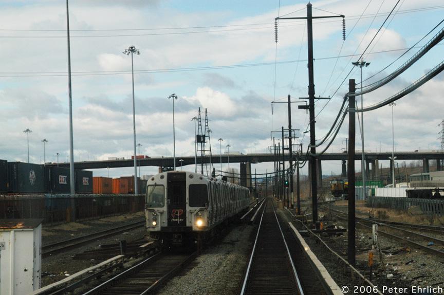(193k, 864x574)<br><b>Country:</b> United States<br><b>City:</b> Kearny, NJ<br><b>System:</b> PATH<br><b>Location:</b> Passing Meadows Yard, Kearny <br><b>Photo by:</b> Peter Ehrlich<br><b>Date:</b> 1/25/2006<br><b>Notes:</b> WTC-bound train passing Meadows Yard in Kearny.<br><b>Viewed (this week/total):</b> 0 / 3630
