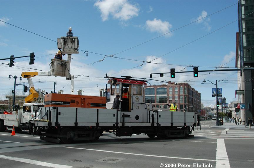 (174k, 864x574)<br><b>Country:</b> United States<br><b>City:</b> San Francisco/Bay Area, CA<br><b>System:</b> SF MUNI<br><b>Line:</b> MUNI 3rd Street Light Rail<br><b>Location:</b> <b><u>Caltrain/4th & King</u></b> <br><b>Photo by:</b> Peter Ehrlich<br><b>Date:</b> 4/10/2006<br><b>Notes:</b> MUNI 1923 work car C-1 testing trackage. Turning from 4th Street onto King Street. Overhead wire installation is progressing here.<br><b>Viewed (this week/total):</b> 0 / 1482