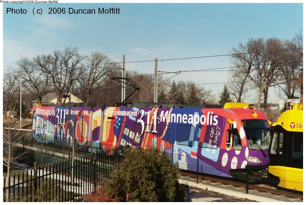 (192k, 1044x699)<br><b>Country:</b> United States<br><b>City:</b> Minneapolis, MN<br><b>System:</b> MNDOT Light Rail Transit<br><b>Line:</b> Hiawatha Line<br><b>Location:</b> <b><u>V. A. Medical Center </b></u><br><b>Car:</b> Bombardier Flexity Swift  121 <br><b>Photo by:</b> Duncan Moffitt<br><b>Date:</b> 2/3/2006<br><b>Notes:</b> Southbound/outbound arriving at the V.A. Medical Center station. The car is advertising the new 311 phone number for information regarding city services (if you live here!).<br><b>Viewed (this week/total):</b> 3 / 1843