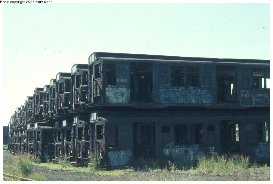 (91k, 920x620)<br><b>Country:</b> United States<br><b>City:</b> New York<br><b>System:</b> New York City Transit<br><b>Location:</b> Naporano Bros. Scrap Yard, Newark, NJ<br><b>Car:</b> R-1/R-9 Series   <br><b>Photo by:</b> Harv Kahn<br><b>Date:</b> 7/18/1976<br><b>Viewed (this week/total):</b> 2 / 6898