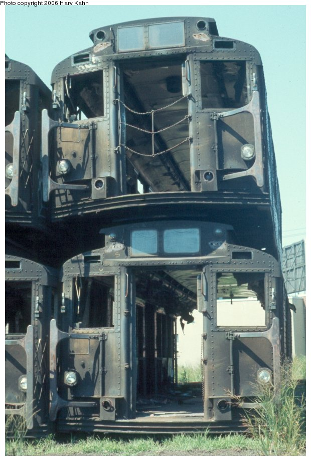 (118k, 620x920)<br><b>Country:</b> United States<br><b>City:</b> New York<br><b>System:</b> New York City Transit<br><b>Location:</b> Naporano Bros. Scrap Yard, Newark, NJ<br><b>Car:</b> R-1/R-9 Series   <br><b>Photo by:</b> Harv Kahn<br><b>Date:</b> 7/18/1976<br><b>Viewed (this week/total):</b> 10 / 5110