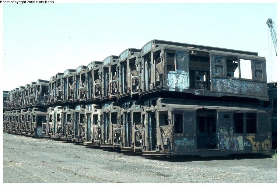 (126k, 920x611)<br><b>Country:</b> United States<br><b>City:</b> New York<br><b>System:</b> New York City Transit<br><b>Location:</b> Naporano Bros. Scrap Yard, Newark, NJ<br><b>Car:</b> R-1/R-9 Series   <br><b>Photo by:</b> Harv Kahn<br><b>Date:</b> 7/18/1976<br><b>Viewed (this week/total):</b> 0 / 6156