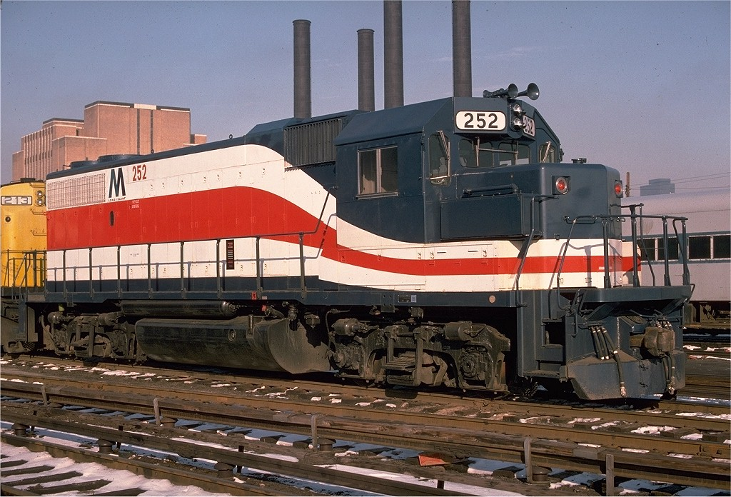 (235k, 1024x696)<br><b>Country:</b> United States<br><b>City:</b> New York<br><b>System:</b> Long Island Rail Road<br><b>Line:</b> LIRR Long Island City<br><b>Location:</b> Long Island City <br><b>Car:</b> LIRR GP38-2 (Diesel) 252 <br><b>Photo by:</b> Bill Madden<br><b>Collection of:</b> Joe Testagrose<br><b>Date:</b> 2/4/1976<br><b>Viewed (this week/total):</b> 1 / 1658