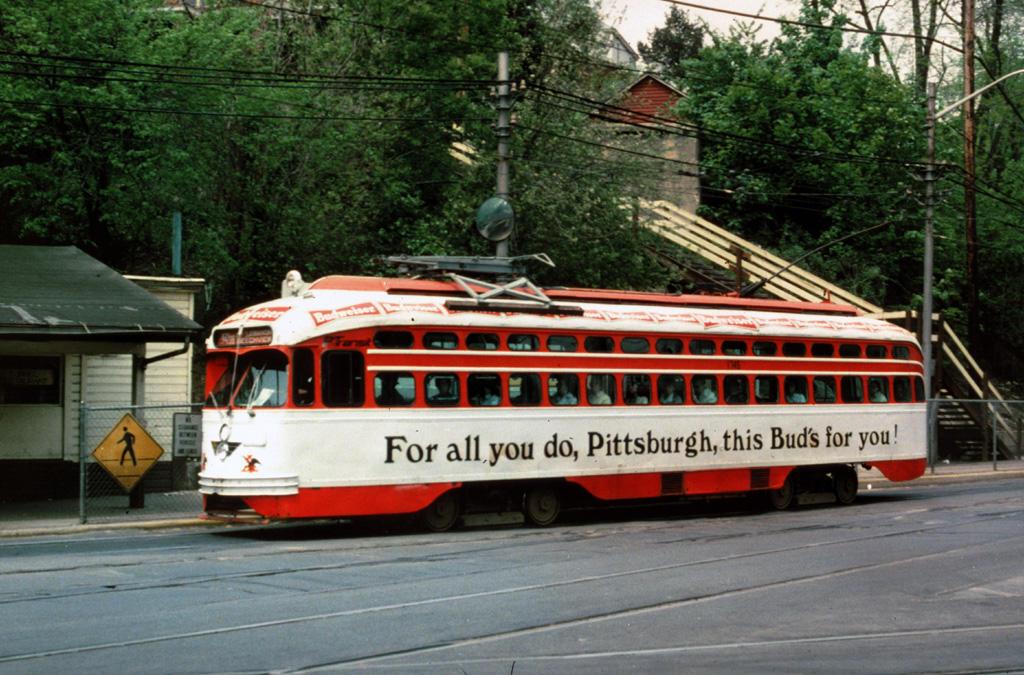 (152k, 1024x675)<br><b>Country:</b> United States<br><b>City:</b> Pittsburgh, PA<br><b>System:</b> PAT <br><b>Location:</b> South Hills Jct. <br><b>Car:</b> Pittsburgh Railways/PAT PCC 1745 <br><b>Photo by:</b> Carl H. Sturner<br><b>Collection of:</b> Chris Leverett<br><b>Date:</b> 5/17/1983<br><b>Notes:</b> Budwiser ad livery.<br><b>Viewed (this week/total):</b> 0 / 1633