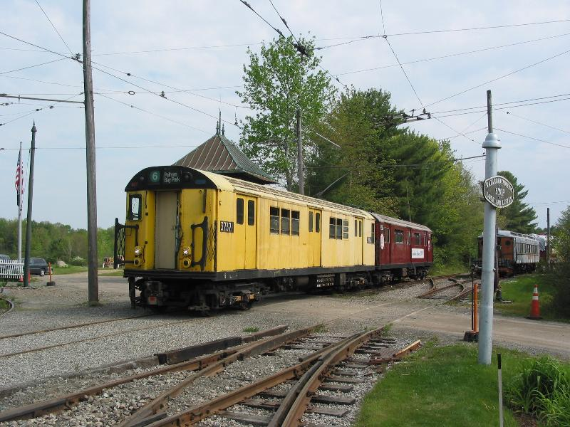 (100k, 800x600)<br><b>Country:</b> United States<br><b>City:</b> Kennebunk, ME<br><b>System:</b> Seashore Trolley Museum <br><b>Car:</b> R-22 (St. Louis, 1957-58) 37371 <br><b>Photo by:</b> Jack Naugler<br><b>Date:</b> 5/27/2006<br><b>Notes:</b> IRT R-22 # 7371 leads a two car train from the Well, across the Library Crossing at the Seashore Trolley Museum on Saturday 27 May, 2006 for a mainline run.<br><b>Viewed (this week/total):</b> 1 / 3079