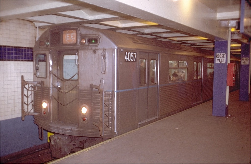 (165k, 1024x669)<br><b>Country:</b> United States<br><b>City:</b> New York<br><b>System:</b> New York City Transit<br><b>Line:</b> IND Queens Boulevard Line<br><b>Location:</b> Roosevelt Avenue <br><b>Route:</b> EE<br><b>Car:</b> R-38 (St. Louis, 1966-1967)  4057 <br><b>Photo by:</b> Steve Zabel<br><b>Collection of:</b> Joe Testagrose<br><b>Date:</b> 12/28/1971<br><b>Viewed (this week/total):</b> 1 / 5488