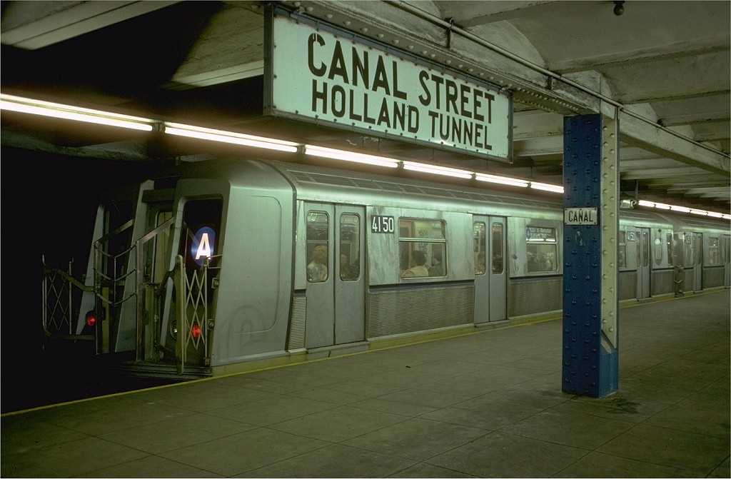 (165k, 1024x671)<br><b>Country:</b> United States<br><b>City:</b> New York<br><b>System:</b> New York City Transit<br><b>Line:</b> IND 8th Avenue Line<br><b>Location:</b> Canal Street-Holland Tunnel <br><b>Route:</b> A<br><b>Car:</b> R-40 (St. Louis, 1968)  4150 <br><b>Photo by:</b> Doug Grotjahn<br><b>Collection of:</b> Joe Testagrose<br><b>Date:</b> 10/24/1977<br><b>Viewed (this week/total):</b> 5 / 14706