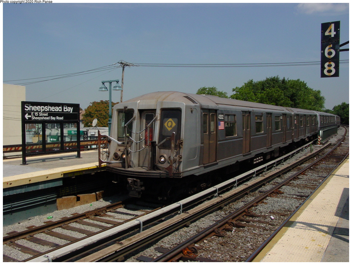 (84k, 820x620)<br><b>Country:</b> United States<br><b>City:</b> New York<br><b>System:</b> New York City Transit<br><b>Line:</b> BMT Brighton Line<br><b>Location:</b> Sheepshead Bay <br><b>Route:</b> Q<br><b>Car:</b> R-40 (St. Louis, 1968)  4202 <br><b>Photo by:</b> Richard Panse<br><b>Date:</b> 8/1/2002<br><b>Viewed (this week/total):</b> 2 / 4060