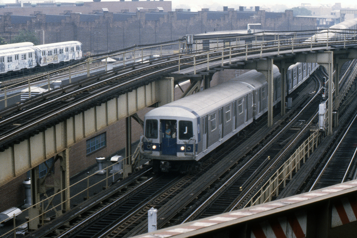 (574k, 1044x705)<br><b>Country:</b> United States<br><b>City:</b> New York<br><b>System:</b> New York City Transit<br><b>Line:</b> BMT Nassau Street/Jamaica Line<br><b>Location:</b> Broadway/East New York (Broadway Junction) <br><b>Route:</b> J<br><b>Car:</b> R-42 (St. Louis, 1969-1970)   <br><b>Photo by:</b> Steve Hoskins<br><b>Collection of:</b> David Pirmann<br><b>Date:</b> 8/1979<br><b>Viewed (this week/total):</b> 3 / 8356