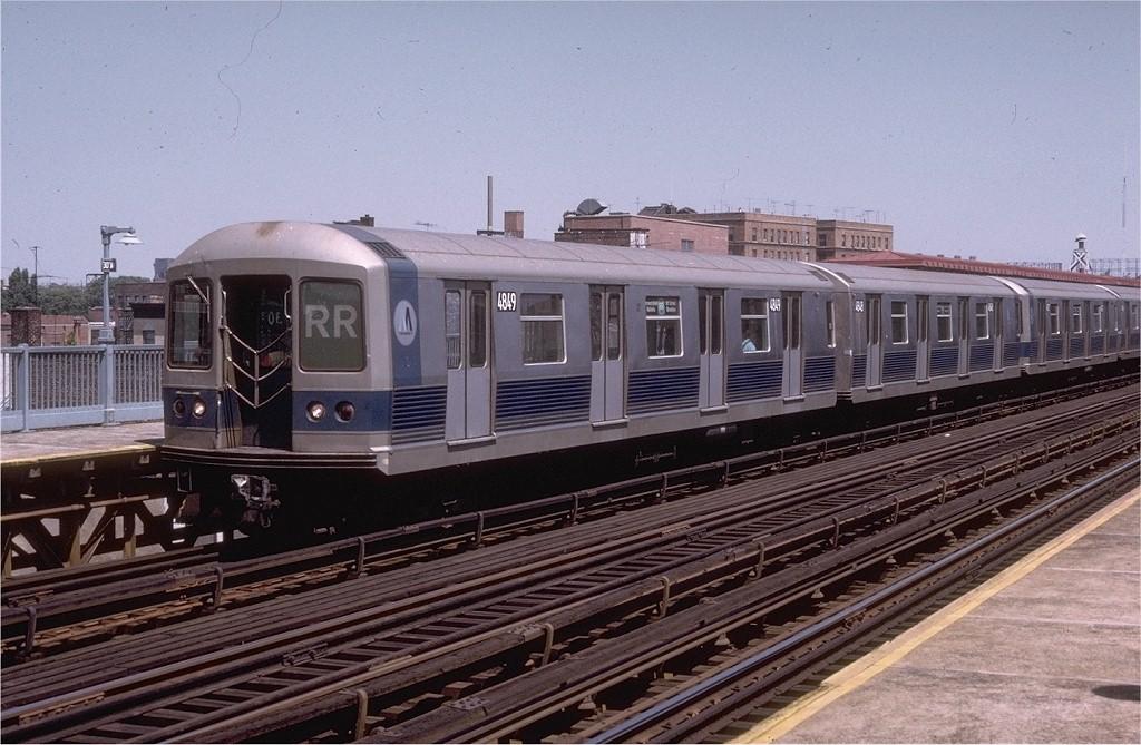 (203k, 1024x669)<br><b>Country:</b> United States<br><b>City:</b> New York<br><b>System:</b> New York City Transit<br><b>Line:</b> BMT Astoria Line<br><b>Location:</b> 30th/Grand Aves. <br><b>Route:</b> RR<br><b>Car:</b> R-42 (St. Louis, 1969-1970)  4849 <br><b>Photo by:</b> Doug Grotjahn<br><b>Collection of:</b> Joe Testagrose<br><b>Date:</b> 8/5/1973<br><b>Viewed (this week/total):</b> 0 / 3271