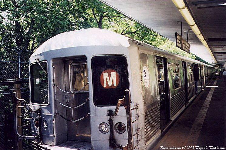 (122k, 745x495)<br><b>Country:</b> United States<br><b>City:</b> New York<br><b>System:</b> New York City Transit<br><b>Line:</b> BMT Myrtle Avenue Line<br><b>Location:</b> Metropolitan Avenue <br><b>Route:</b> M<br><b>Car:</b> R-42 (St. Louis, 1969-1970)  4853 <br><b>Photo by:</b> Wayne Whitehorne<br><b>Date:</b> 1998<br><b>Viewed (this week/total):</b> 0 / 4840