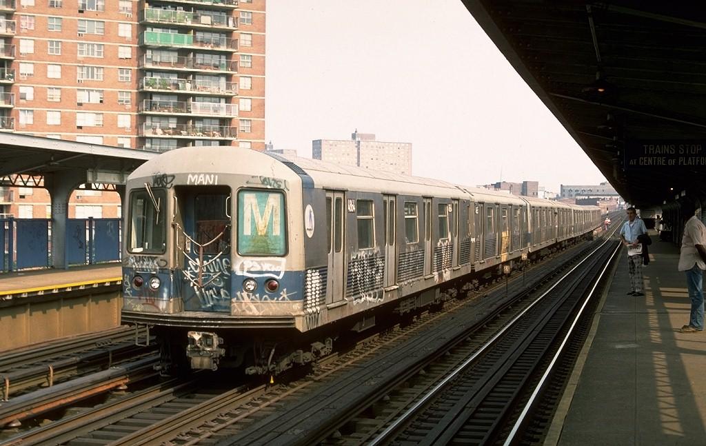 (199k, 1024x647)<br><b>Country:</b> United States<br><b>City:</b> New York<br><b>System:</b> New York City Transit<br><b>Line:</b> BMT Nassau Street/Jamaica Line<br><b>Location:</b> Lorimer Street <br><b>Route:</b> M<br><b>Car:</b> R-42 (St. Louis, 1969-1970)  4864 <br><b>Photo by:</b> Ed McKernan<br><b>Collection of:</b> Joe Testagrose<br><b>Date:</b> 8/12/1976<br><b>Viewed (this week/total):</b> 10 / 4196
