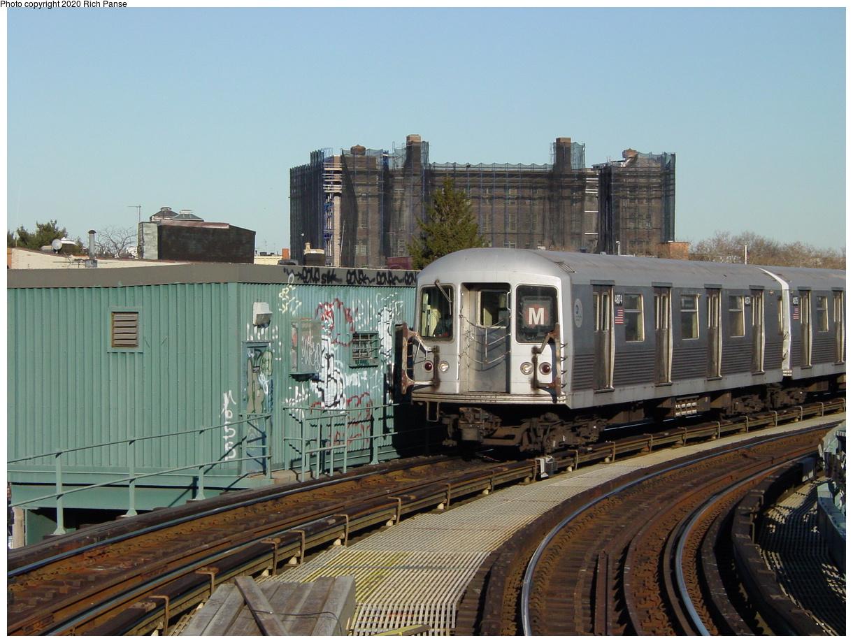 (83k, 820x620)<br><b>Country:</b> United States<br><b>City:</b> New York<br><b>System:</b> New York City Transit<br><b>Line:</b> BMT Myrtle Avenue Line<br><b>Location:</b> Seneca Avenue <br><b>Route:</b> M<br><b>Car:</b> R-42 (St. Louis, 1969-1970)  4874 <br><b>Photo by:</b> Richard Panse<br><b>Date:</b> 1/25/2002<br><b>Viewed (this week/total):</b> 0 / 3755