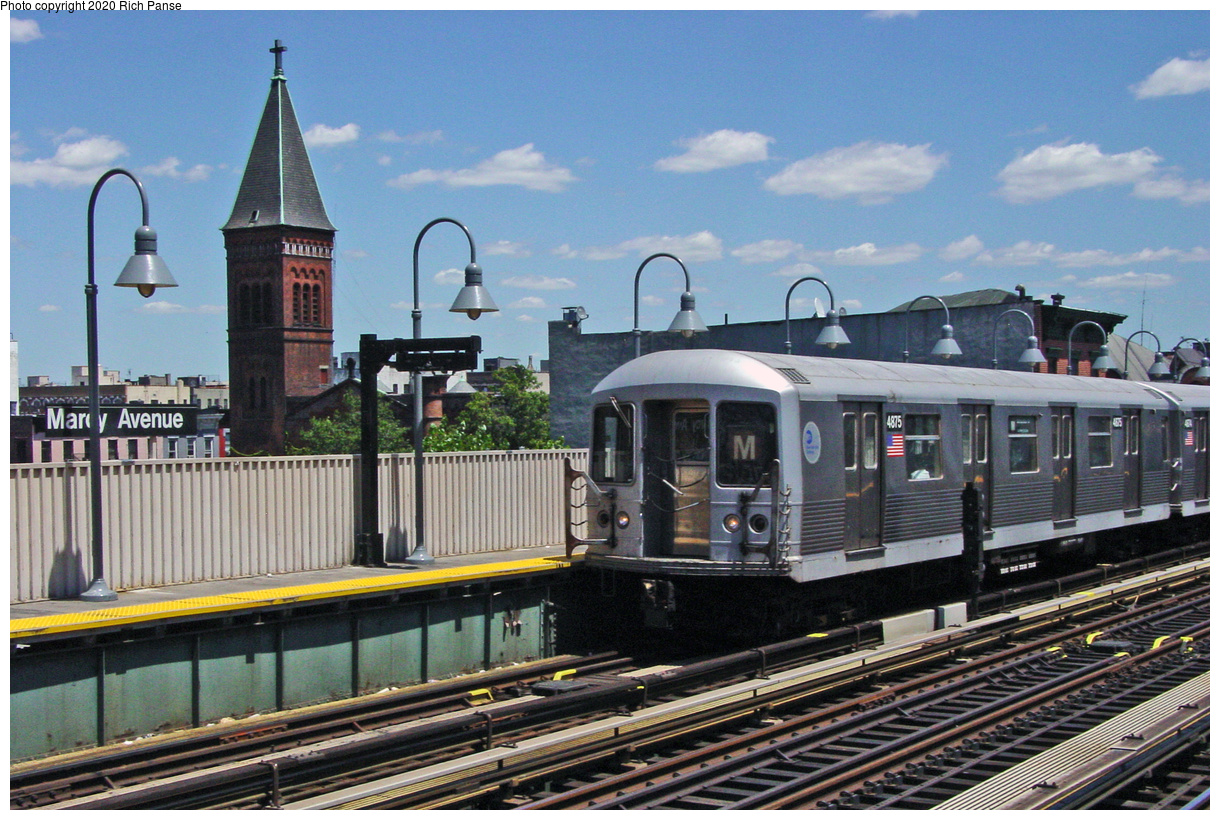 (74k, 820x620)<br><b>Country:</b> United States<br><b>City:</b> New York<br><b>System:</b> New York City Transit<br><b>Line:</b> BMT Nassau Street/Jamaica Line<br><b>Location:</b> Marcy Avenue <br><b>Route:</b> M<br><b>Car:</b> R-42 (St. Louis, 1969-1970)  4875 <br><b>Photo by:</b> Richard Panse<br><b>Date:</b> 7/11/2002<br><b>Viewed (this week/total):</b> 1 / 3285