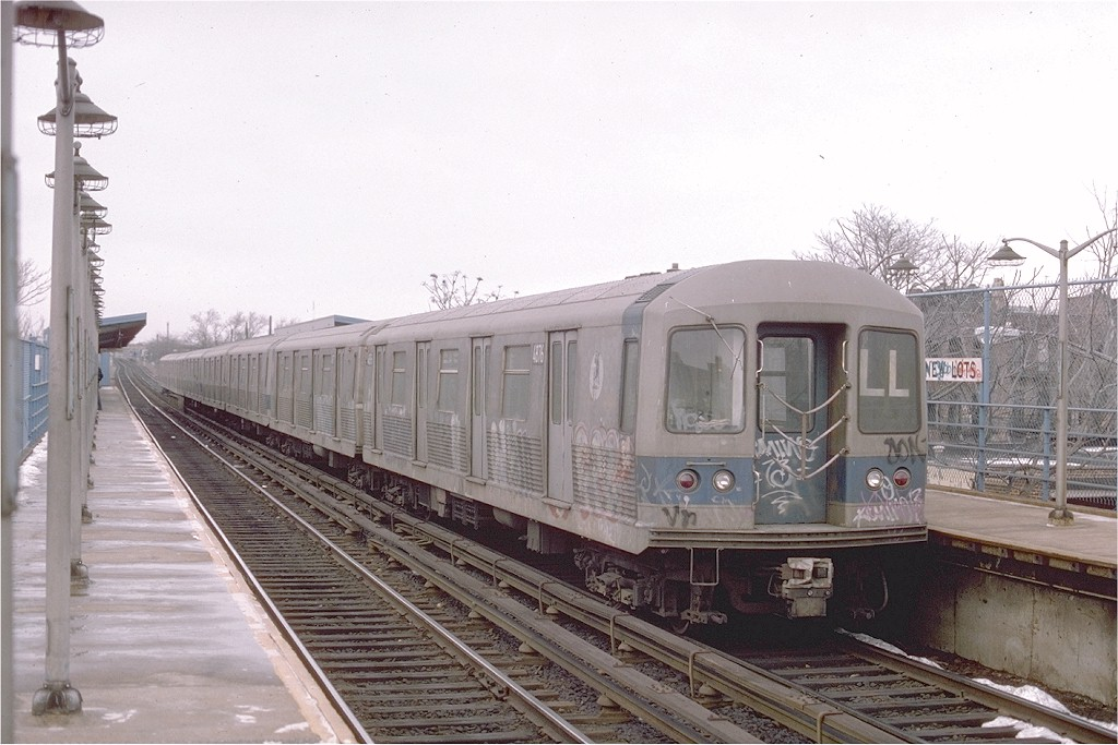 (184k, 1024x683)<br><b>Country:</b> United States<br><b>City:</b> New York<br><b>System:</b> New York City Transit<br><b>Line:</b> BMT Canarsie Line<br><b>Location:</b> New Lots Avenue <br><b>Route:</b> LL<br><b>Car:</b> R-42 (St. Louis, 1969-1970)  4876 <br><b>Photo by:</b> Ed McKernan<br><b>Collection of:</b> Joe Testagrose<br><b>Date:</b> 2/1976<br><b>Viewed (this week/total):</b> 2 / 3301