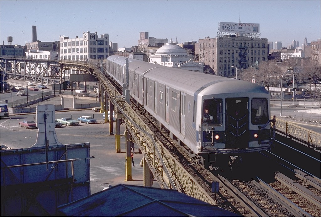 (235k, 1024x692)<br><b>Country:</b> United States<br><b>City:</b> New York<br><b>System:</b> New York City Transit<br><b>Line:</b> BMT Nassau Street/Jamaica Line<br><b>Location:</b> Marcy Avenue <br><b>Route:</b> J<br><b>Car:</b> R-42 (St. Louis, 1969-1970)  4877 <br><b>Photo by:</b> Steve Zabel<br><b>Collection of:</b> Joe Testagrose<br><b>Date:</b> 3/23/1979<br><b>Viewed (this week/total):</b> 0 / 4955