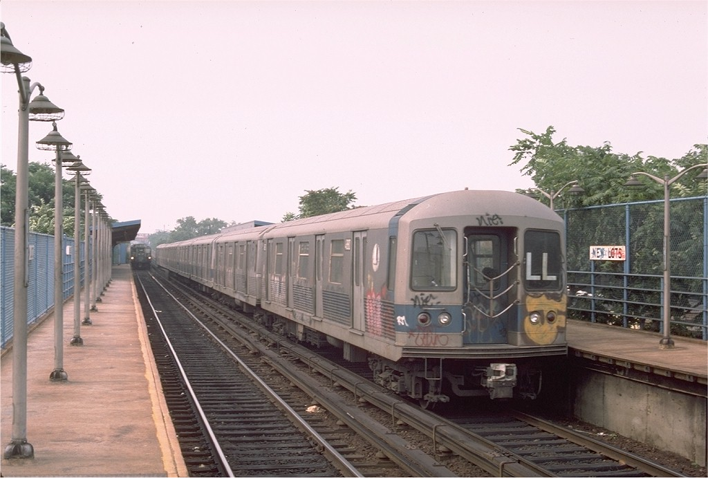 (166k, 1024x691)<br><b>Country:</b> United States<br><b>City:</b> New York<br><b>System:</b> New York City Transit<br><b>Line:</b> BMT Canarsie Line<br><b>Location:</b> New Lots Avenue <br><b>Route:</b> LL<br><b>Car:</b> R-42 (St. Louis, 1969-1970)  4880 <br><b>Photo by:</b> Ed McKernan<br><b>Collection of:</b> Joe Testagrose<br><b>Date:</b> 8/12/1976<br><b>Viewed (this week/total):</b> 4 / 3832