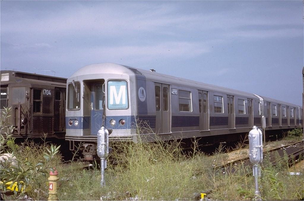 (228k, 1024x679)<br><b>Country:</b> United States<br><b>City:</b> New York<br><b>System:</b> New York City Transit<br><b>Location:</b> Fresh Pond Yard<br><b>Route:</b> M<br><b>Car:</b> R-42 (St. Louis, 1969-1970)  4898 <br><b>Photo by:</b> Steve Zabel<br><b>Collection of:</b> Joe Testagrose<br><b>Date:</b> 8/27/1972<br><b>Viewed (this week/total):</b> 3 / 6605