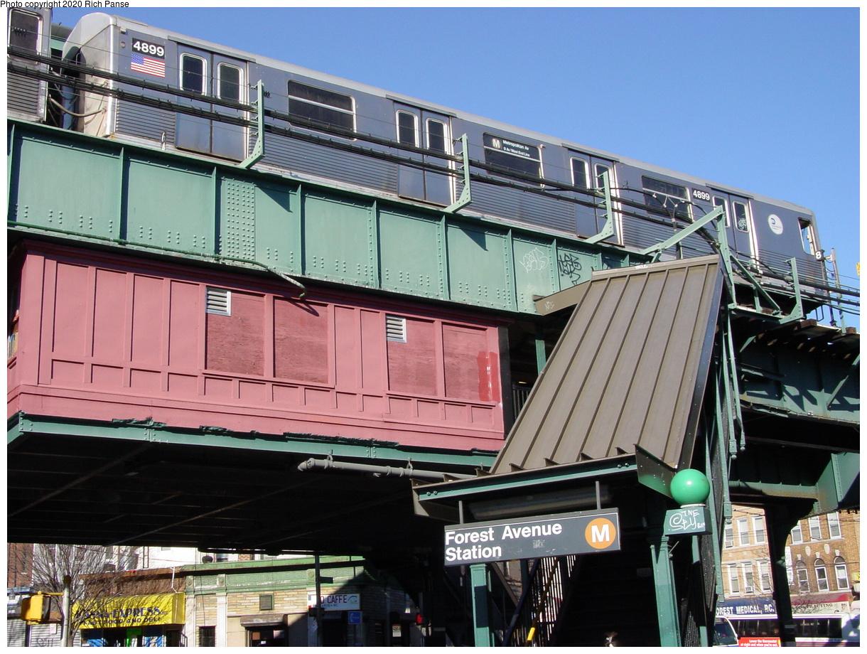 (97k, 820x620)<br><b>Country:</b> United States<br><b>City:</b> New York<br><b>System:</b> New York City Transit<br><b>Line:</b> BMT Myrtle Avenue Line<br><b>Location:</b> Forest Avenue <br><b>Car:</b> R-42 (St. Louis, 1969-1970)  4899 <br><b>Photo by:</b> Richard Panse<br><b>Date:</b> 1/25/2002<br><b>Viewed (this week/total):</b> 2 / 6743