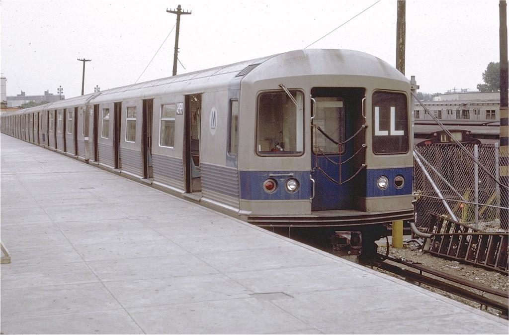(181k, 1024x673)<br><b>Country:</b> United States<br><b>City:</b> New York<br><b>System:</b> New York City Transit<br><b>Line:</b> BMT Canarsie Line<br><b>Location:</b> Rockaway Parkway <br><b>Route:</b> LL<br><b>Car:</b> R-42 (St. Louis, 1969-1970)  4899 <br><b>Photo by:</b> Doug Grotjahn<br><b>Collection of:</b> Joe Testagrose<br><b>Date:</b> 7/11/1971<br><b>Viewed (this week/total):</b> 0 / 3294