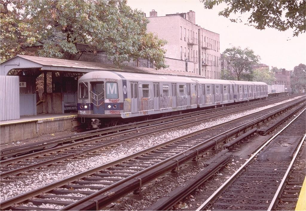 (314k, 1024x706)<br><b>Country:</b> United States<br><b>City:</b> New York<br><b>System:</b> New York City Transit<br><b>Line:</b> BMT Brighton Line<br><b>Location:</b> Avenue H <br><b>Route:</b> M<br><b>Car:</b> R-42 (St. Louis, 1969-1970)  4900 <br><b>Photo by:</b> Doug Grotjahn<br><b>Collection of:</b> Joe Testagrose<br><b>Date:</b> 10/27/1975<br><b>Viewed (this week/total):</b> 1 / 4040