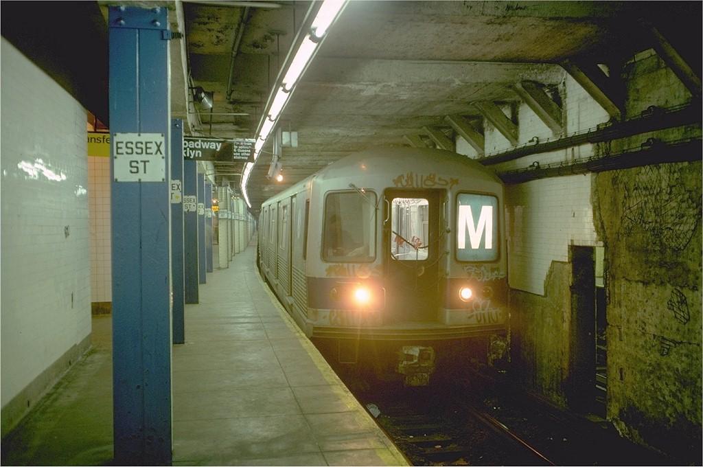 (178k, 1024x680)<br><b>Country:</b> United States<br><b>City:</b> New York<br><b>System:</b> New York City Transit<br><b>Line:</b> BMT Nassau Street/Jamaica Line<br><b>Location:</b> Essex Street <br><b>Route:</b> M<br><b>Car:</b> R-42 (St. Louis, 1969-1970)  4902 <br><b>Photo by:</b> Doug Grotjahn<br><b>Collection of:</b> Joe Testagrose<br><b>Date:</b> 1/3/1977<br><b>Viewed (this week/total):</b> 9 / 6308