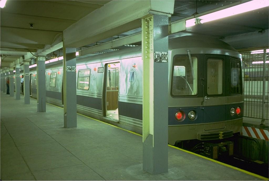 (161k, 1024x690)<br><b>Country:</b> United States<br><b>City:</b> New York<br><b>System:</b> New York City Transit<br><b>Line:</b> IND 8th Avenue Line<br><b>Location:</b> Chambers Street/World Trade Center <br><b>Route:</b> E<br><b>Car:</b> R-46 (Pullman-Standard, 1974-75) 1000 <br><b>Photo by:</b> Doug Grotjahn<br><b>Collection of:</b> Joe Testagrose<br><b>Date:</b> 6/26/1977<br><b>Viewed (this week/total):</b> 4 / 6677