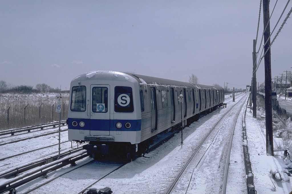 (204k, 1024x681)<br><b>Country:</b> United States<br><b>City:</b> New York<br><b>System:</b> New York City Transit<br><b>Line:</b> IND Rockaway<br><b>Location:</b> Howard Beach <br><b>Route:</b> JFK<br><b>Car:</b> R-46 (Pullman-Standard, 1974-75) 1238 <br><b>Photo by:</b> Steve Zabel<br><b>Collection of:</b> Joe Testagrose<br><b>Date:</b> 4/7/1982<br><b>Viewed (this week/total):</b> 2 / 7738