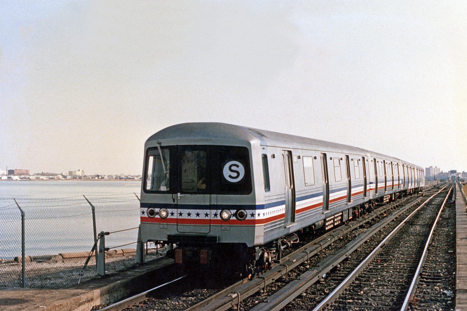(228k, 820x537)<br><b>Country:</b> United States<br><b>City:</b> New York<br><b>System:</b> New York City Transit<br><b>Line:</b> IND Rockaway<br><b>Location:</b> Jamaica Bay Crossing<br><b>Car:</b> R-46 (Pullman-Standard, 1974-75) 680 <br><b>Photo by:</b> Constantine Steffan<br><b>Notes:</b> Bicentennial stripe<br><b>Viewed (this week/total):</b> 0 / 4031