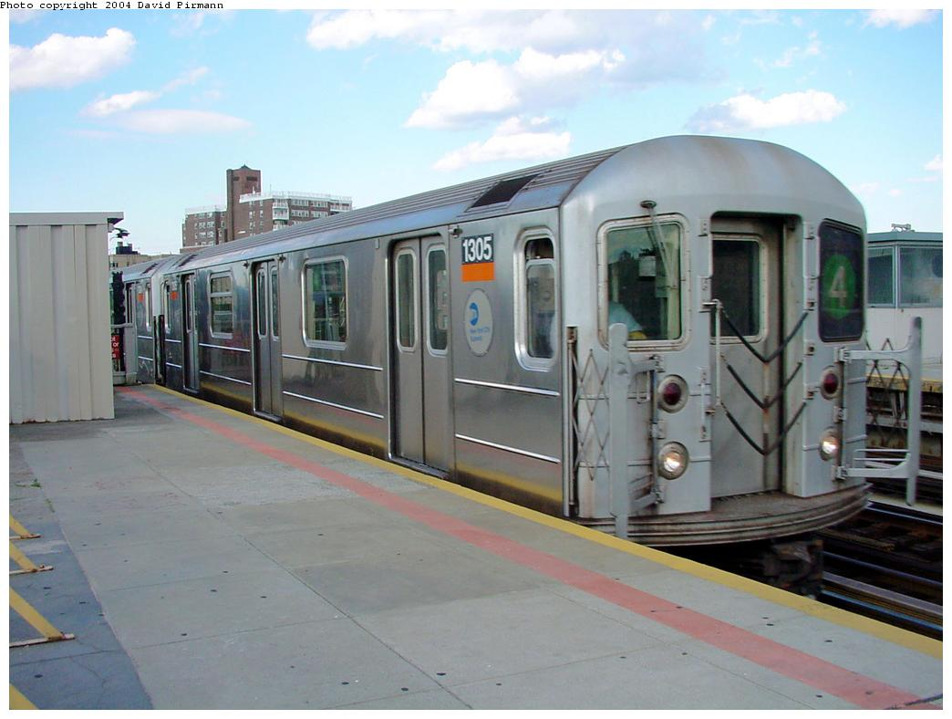 (100k, 1044x788)<br><b>Country:</b> United States<br><b>City:</b> New York<br><b>System:</b> New York City Transit<br><b>Line:</b> IRT Woodlawn Line<br><b>Location:</b> Bedford Park Boulevard <br><b>Route:</b> 4<br><b>Car:</b> R-62 (Kawasaki, 1983-1985)  1305 <br><b>Photo by:</b> David Pirmann<br><b>Date:</b> 7/12/2001<br><b>Viewed (this week/total):</b> 0 / 6163