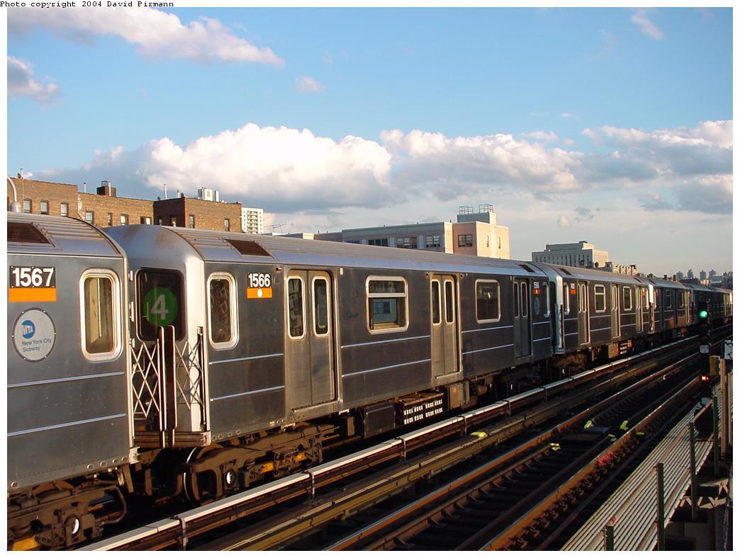 (125k, 1044x788)<br><b>Country:</b> United States<br><b>City:</b> New York<br><b>System:</b> New York City Transit<br><b>Line:</b> IRT Woodlawn Line<br><b>Location:</b> 167th Street <br><b>Route:</b> 4<br><b>Car:</b> R-62 (Kawasaki, 1983-1985)  1566 <br><b>Photo by:</b> David Pirmann<br><b>Date:</b> 7/12/2001<br><b>Viewed (this week/total):</b> 4 / 3997