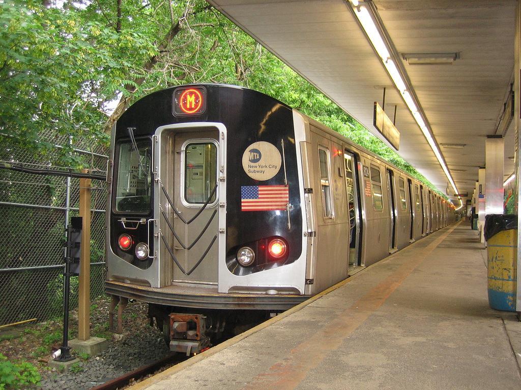 (196k, 1024x768)<br><b>Country:</b> United States<br><b>City:</b> New York<br><b>System:</b> New York City Transit<br><b>Line:</b> BMT Myrtle Avenue Line<br><b>Location:</b> Metropolitan Avenue <br><b>Route:</b> Shuttle<br><b>Car:</b> R-143 (Kawasaki, 2001-2002) 8124 <br><b>Photo by:</b> Michael Hodurski<br><b>Date:</b> 6/4/2006<br><b>Viewed (this week/total):</b> 0 / 3628