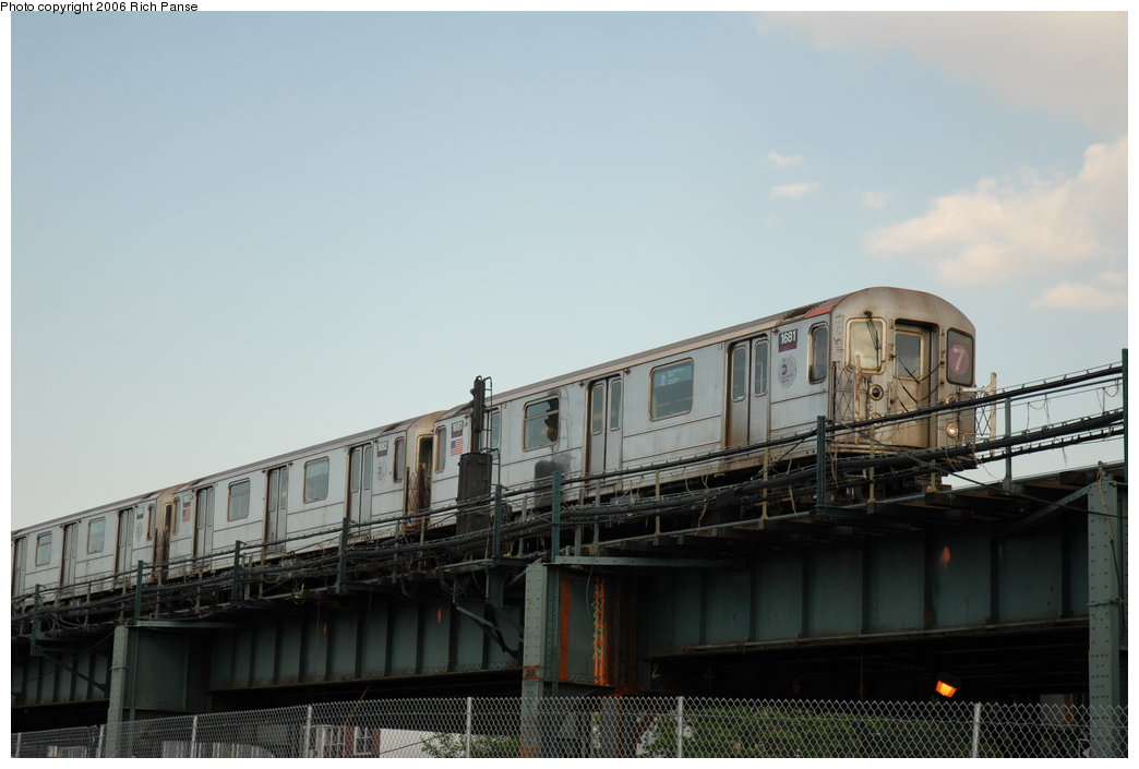 (145k, 1044x705)<br><b>Country:</b> United States<br><b>City:</b> New York<br><b>System:</b> New York City Transit<br><b>Line:</b> IRT Flushing Line<br><b>Location:</b> 69th Street/Fisk Avenue <br><b>Route:</b> 7<br><b>Car:</b> R-62A (Bombardier, 1984-1987)  1681 <br><b>Photo by:</b> Richard Panse<br><b>Date:</b> 6/13/2006<br><b>Notes:</b> El crossing the BQE along Roosevelt Ave.<br><b>Viewed (this week/total):</b> 0 / 2657
