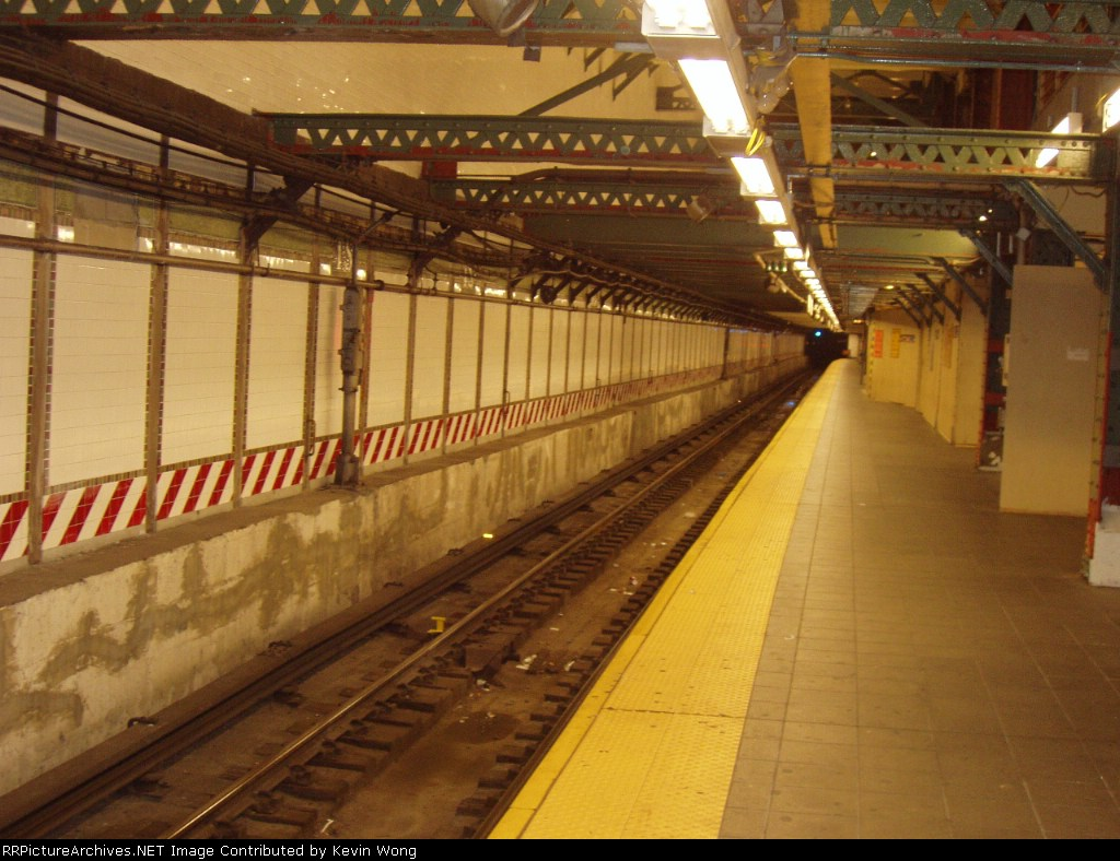 (181k, 1024x788)<br><b>Country:</b> United States<br><b>City:</b> New York<br><b>System:</b> New York City Transit<br><b>Line:</b> IRT Flushing Line<br><b>Location:</b> Times Square <br><b>Photo by:</b> Kevin Wong<br><b>Date:</b> 4/29/2006<br><b>Notes:</b> Track one with empty platform.<br><b>Viewed (this week/total):</b> 0 / 3021