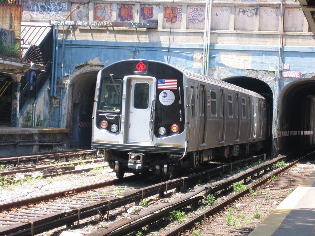 (178k, 1024x768)<br><b>Country:</b> United States<br><b>City:</b> New York<br><b>System:</b> New York City Transit<br><b>Line:</b> BMT Sea Beach Line<br><b>Location:</b> 18th Avenue <br><b>Car:</b> R-160A-2 (Alstom, 2005-2008, 5 car sets)  8653 <br><b>Photo by:</b> Michael Hodurski<br><b>Date:</b> 6/21/2006<br><b>Notes:</b> Test train on the Sea Beach line middle (express) track.<br><b>Viewed (this week/total):</b> 0 / 4323