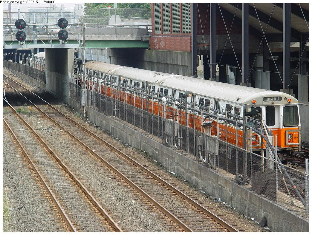 (283k, 1044x788)<br><b>Country:</b> United States<br><b>City:</b> Boston, MA<br><b>System:</b> MBTA<br><b>Line:</b> MBTA Orange Line<br><b>Location:</b> Back Bay <br><b>Car:</b> MBTA 01200 Series (Hawker-Siddley, 1980-1981)   <br><b>Photo by:</b> S.L. Peters<br><b>Date:</b> 7/6/2006<br><b>Notes:</b> Outbound Orange Line train arriving at Back Bay Station.<br><b>Viewed (this week/total):</b> 0 / 2234