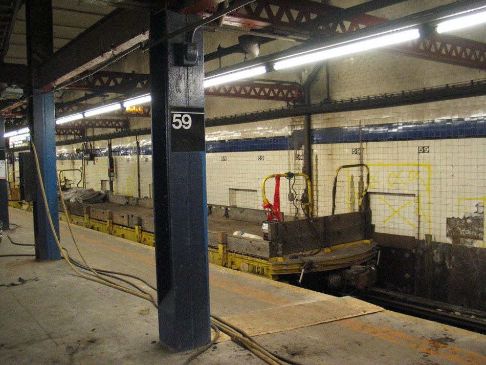 (165k, 950x713)<br><b>Country:</b> United States<br><b>City:</b> New York<br><b>System:</b> New York City Transit<br><b>Line:</b> IND 8th Avenue Line<br><b>Location:</b> 59th Street/Columbus Circle <br><b>Route:</b> Work Service<br><b>Car:</b> Flat Car  <br><b>Photo by:</b> David of Broadway<br><b>Date:</b> 7/16/2006<br><b>Notes:</b> Work train at Columbus Circle.<br><b>Viewed (this week/total):</b> 0 / 3034