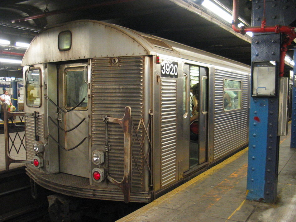 (170k, 950x713)<br><b>Country:</b> United States<br><b>City:</b> New York<br><b>System:</b> New York City Transit<br><b>Line:</b> IND 8th Avenue Line<br><b>Location:</b> 59th Street/Columbus Circle <br><b>Route:</b> E<br><b>Car:</b> R-32 (Budd, 1964)  3920 <br><b>Photo by:</b> David of Broadway<br><b>Date:</b> 7/16/2006<br><b>Notes:</b> E train via Central Park West reroute.<br><b>Viewed (this week/total):</b> 1 / 3986