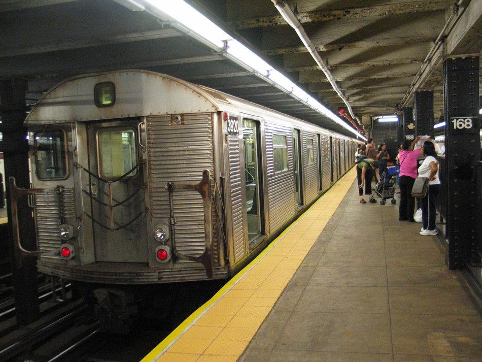 (164k, 950x713)<br><b>Country:</b> United States<br><b>City:</b> New York<br><b>System:</b> New York City Transit<br><b>Line:</b> IND 8th Avenue Line<br><b>Location:</b> 168th Street <br><b>Route:</b> E<br><b>Car:</b> R-32 (Budd, 1964)  3920 <br><b>Photo by:</b> David of Broadway<br><b>Date:</b> 7/16/2006<br><b>Notes:</b> E train via Central Park West reroute.<br><b>Viewed (this week/total):</b> 0 / 3517