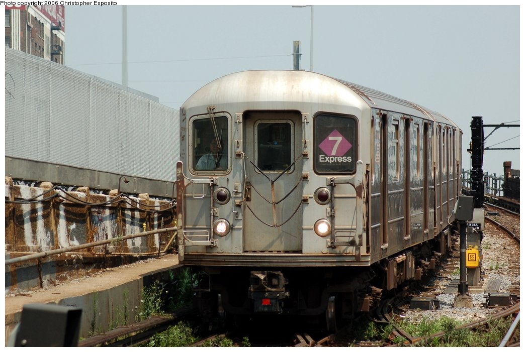 (155k, 1044x701)<br><b>Country:</b> United States<br><b>City:</b> New York<br><b>System:</b> New York City Transit<br><b>Line:</b> IRT Flushing Line<br><b>Location:</b> Viaduct approach east of Hunterspoint Ave. <br><b>Route:</b> 7<br><b>Car:</b> R-62A (Bombardier, 1984-1987)   <br><b>Photo by:</b> Christopher Esposito<br><b>Date:</b> 7/26/2006<br><b>Viewed (this week/total):</b> 2 / 2429