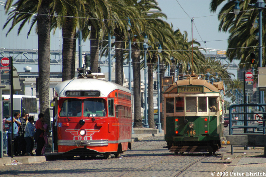 (263k, 864x574)<br><b>Country:</b> United States<br><b>City:</b> San Francisco/Bay Area, CA<br><b>System:</b> SF MUNI<br><b>Location:</b> Embarcadero/Greenwich <br><b>Car:</b> SF MUNI PCC (Ex-SEPTA) (St. Louis Car Co., 1947-1948)  1061 <br><b>Photo by:</b> Peter Ehrlich<br><b>Date:</b> 7/21/2006<br><b>Notes:</b> 1061-Pacific Electric; 496-Melbourne W2.<br><b>Viewed (this week/total):</b> 0 / 556