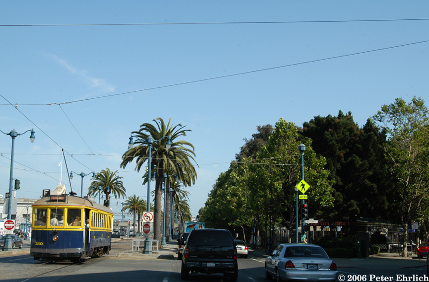 (183k, 864x568)<br><b>Country:</b> United States<br><b>City:</b> San Francisco/Bay Area, CA<br><b>System:</b> SF MUNI<br><b>Location:</b> Embarcadero/Battery <br><b>Car:</b> SF MUNI B-Type (Jewett Car Co, 1914)  130 <br><b>Photo by:</b> Peter Ehrlich<br><b>Date:</b> 7/18/2006<br><b>Notes:</b> Embarcadero/Battery/Lombard outbound, trailing view.  The Fog City Diner is on the right.<br><b>Viewed (this week/total):</b> 0 / 600