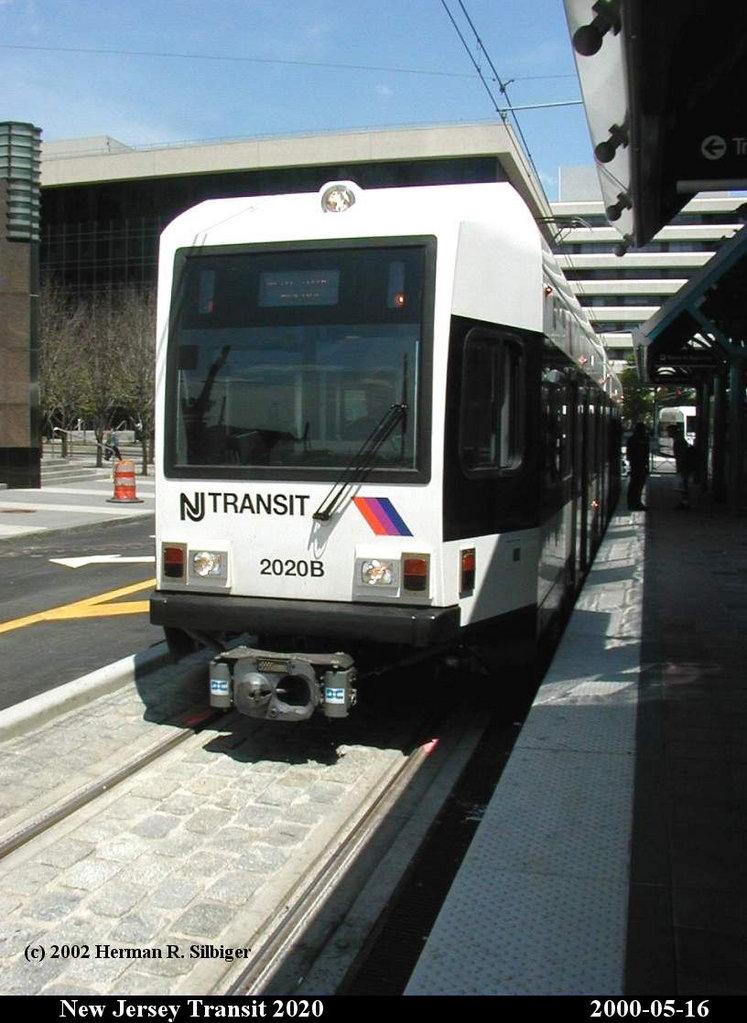 (153k, 747x1023)<br><b>Country:</b> United States<br><b>City:</b> Jersey City, NJ<br><b>System:</b> Hudson Bergen Light Rail<br><b>Location:</b> Exchange Place <br><b>Car:</b> NJT-HBLR LRV (Kinki-Sharyo, 1998-99)  2020 <br><b>Photo by:</b> Herman R. Silbiger<br><b>Date:</b> 5/16/2000<br><b>Viewed (this week/total):</b> 0 / 1213