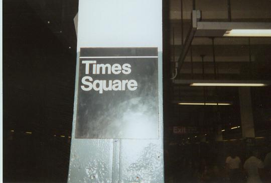 (19k, 540x364)<br><b>Country:</b> United States<br><b>City:</b> New York<br><b>System:</b> New York City Transit<br><b>Line:</b> BMT Broadway Line<br><b>Location:</b> Times Square/42nd Street <br><b>Photo by:</b> Bruce Fedow<br><b>Date:</b> 4/2006<br><b>Notes:</b> New station signage after renovation.<br><b>Viewed (this week/total):</b> 1 / 2198