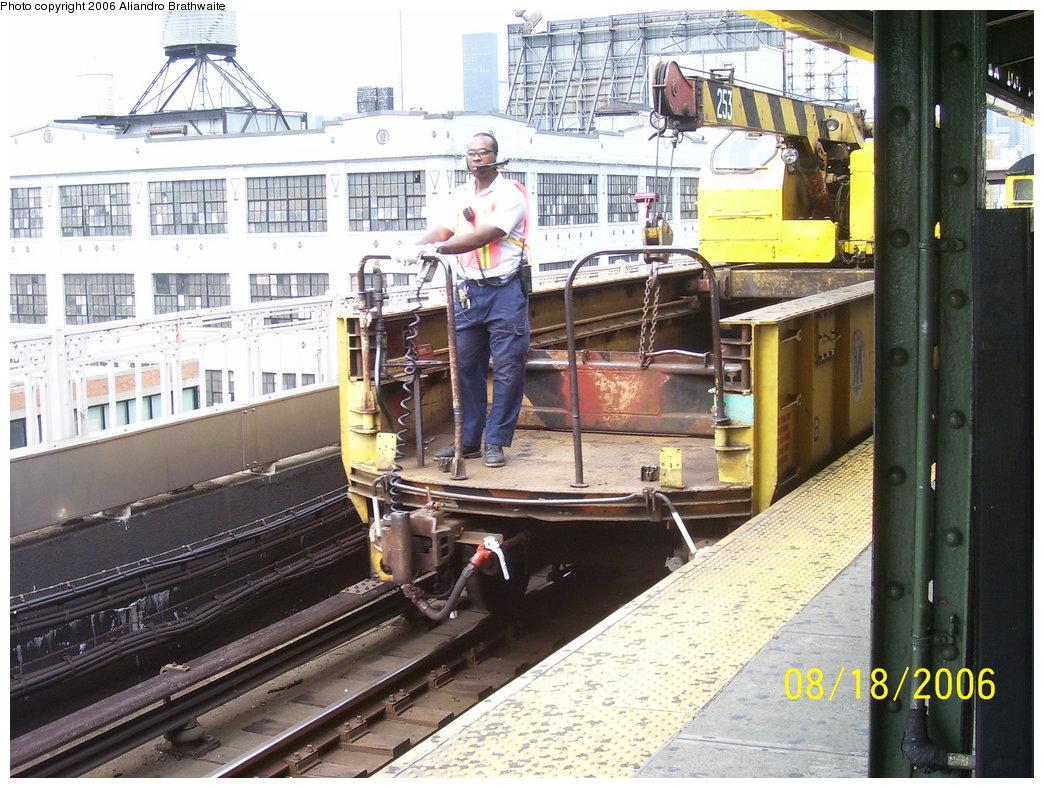 (224k, 1044x788)<br><b>Country:</b> United States<br><b>City:</b> New York<br><b>System:</b> New York City Transit<br><b>Line:</b> BMT Astoria Line<br><b>Location:</b> Queensborough Plaza <br><b>Route:</b> Work Service<br><b>Car:</b> Crane Car 253 <br><b>Photo by:</b> Aliandro Brathwaite<br><b>Date:</b> 8/18/2006<br><b>Viewed (this week/total):</b> 0 / 3059