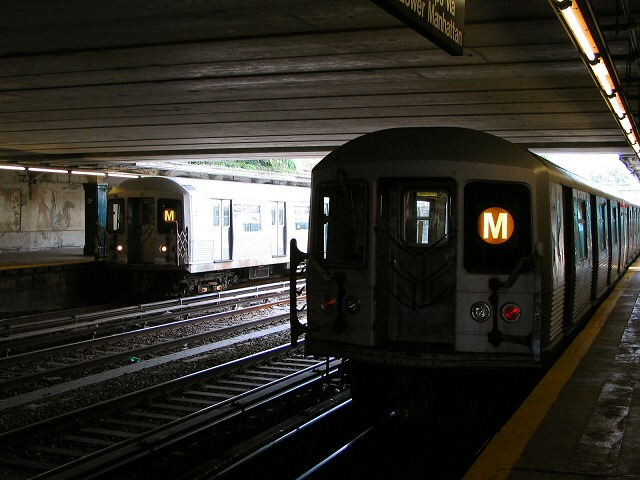 (93k, 640x480)<br><b>Country:</b> United States<br><b>City:</b> New York<br><b>System:</b> New York City Transit<br><b>Line:</b> BMT Sea Beach Line<br><b>Location:</b> Kings Highway <br><b>Route:</b> M<br><b>Car:</b> R-42 (St. Louis, 1969-1970)  4825 <br><b>Photo by:</b> Dante D. Angerville<br><b>Date:</b> 8/22/2006<br><b>Notes:</b> 4825 on left, another R42 on right.<br><b>Viewed (this week/total):</b> 3 / 3314