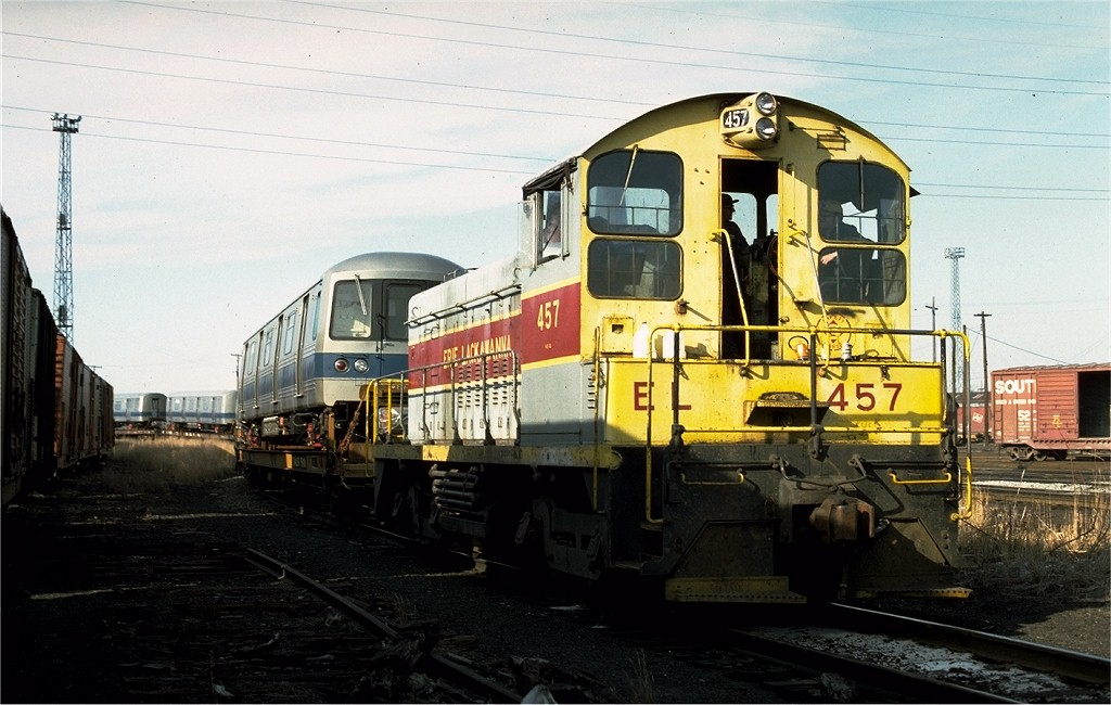 (185k, 1024x650)<br><b>Country:</b> United States<br><b>City:</b> Secaucus, NJ<br><b>System:</b> New York City Transit<br><b>Location:</b> Croxton Yard (NYCTA Equipment Delivery)<br><b>Car:</b> R-46 (Pullman-Standard, 1974-75)  <br><b>Photo by:</b> Ed McKernan<br><b>Collection of:</b> Joe Testagrose<br><b>Date:</b> 3/29/1977<br><b>Notes:</b> Erie-Lackawanna switcher 457 leading a train of R-46 cars being delivered.<br><b>Viewed (this week/total):</b> 3 / 2434