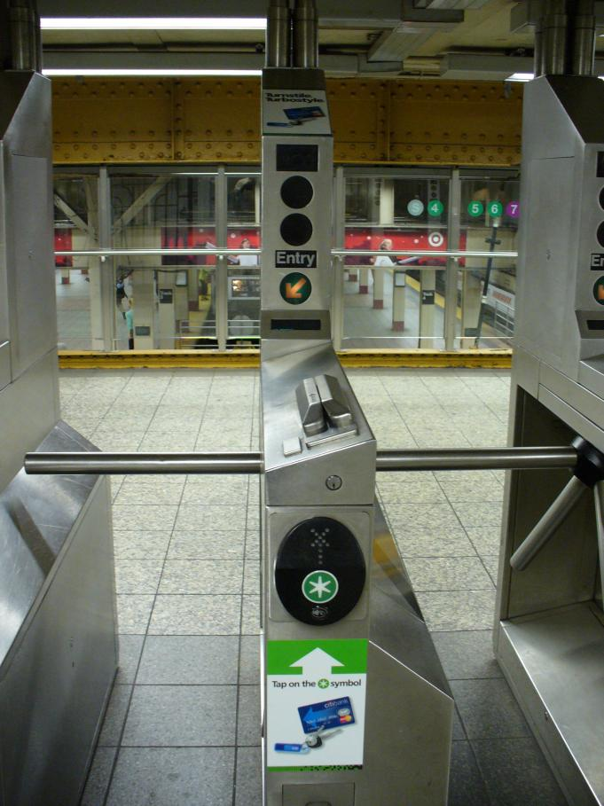 (100k, 681x909)<br><b>Country:</b> United States<br><b>City:</b> New York<br><b>System:</b> New York City Transit<br><b>Line:</b> IRT Times Square-Grand Central Shuttle<br><b>Location:</b> Grand Central <br><b>Photo by:</b> Robbie Rosenfeld<br><b>Date:</b> 8/26/2006<br><b>Notes:</b> New turbo turnstyle with credit card RFID reader installed.<br><b>Viewed (this week/total):</b> 0 / 3017